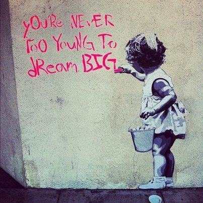 Street art picture that You are never to young to think big.